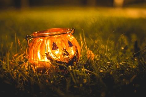 halloween-candle-holder-in-evening-grass-picjumbo-com